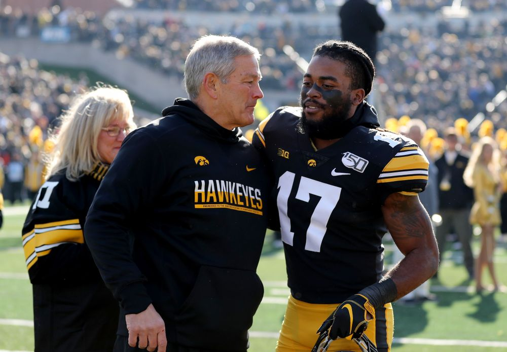 Iowa Hawkeyes head coach Kirk Ferentz hugs defensive back Devonte Young (17) during senior day festivities before their game against the Illinois Fighting Illini Saturday, November 23, 2019 at Kinnick Stadium. (Brian Ray/hawkeyesports.com)