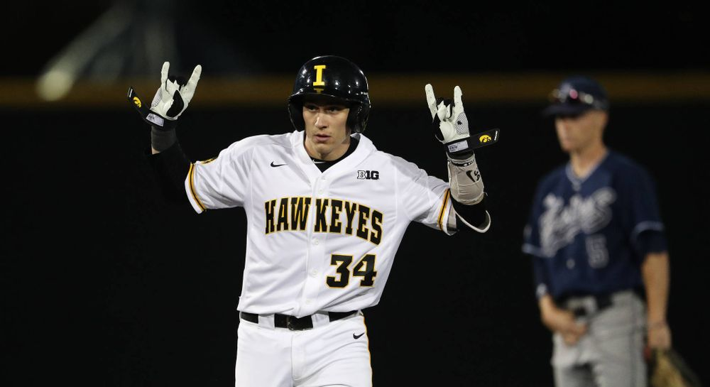 Iowa Hawkeyes catcher Austin Martin (34) doubles during game one against UC Irvine Friday, May 3, 2019 at Duane Banks Field. (Brian Ray/hawkeyesports.com)