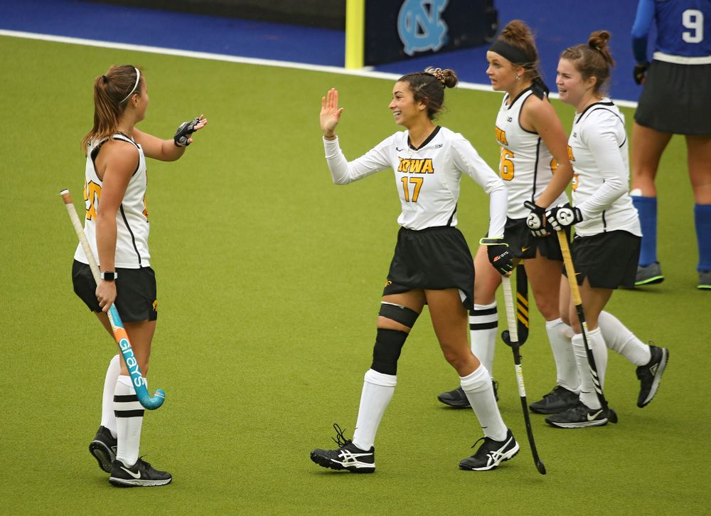 Iowa's Sophie Sunderland (20) high-fives Ciara Smith (17) during the third quarter of their NCAA Tournament First Round match against Duke at Karen Shelton Stadium in Chapel Hill, N.C. on Friday, Nov 15, 2019. (Stephen Mally/hawkeyesports.com)