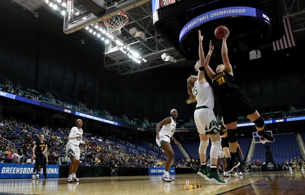 Iowa Hawkeyes forward Megan Gustafson (10) scores her 1,000th point of the year in the regional final against the Baylor Lady Bears in the 2019 NCAA Women's College Basketball Tournament Monday, April 1, 2019 at Greensboro Coliseum in Greensboro, NC. (Brian Ray/hawkeyesports.com)