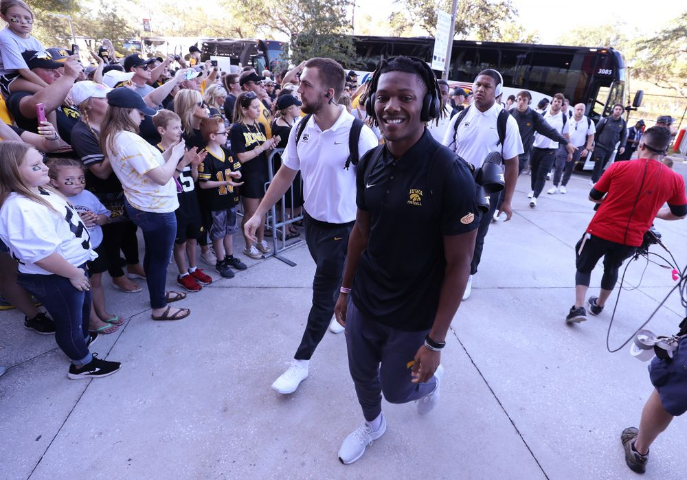 Iowa Hawkeyes wide receiver Brandon Smith (12) smiles as he arrives for the Outback Bowl Tuesday, January 1, 2019 at Raymond James Stadium in Tampa, FL. (Brian Ray/hawkeyesports.com)
