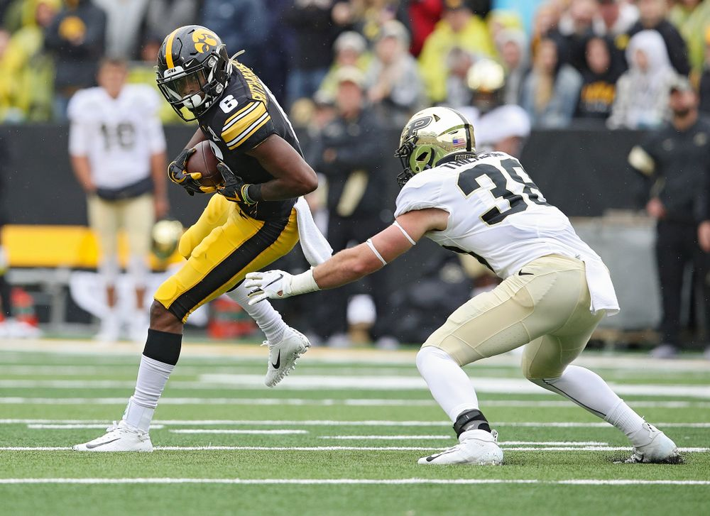 Iowa Hawkeyes wide receiver Ihmir Smith-Marsette (6) spins away from a defender after pulling in a pass during the third quarter of their game at Kinnick Stadium in Iowa City on Saturday, Oct 19, 2019. (Stephen Mally/hawkeyesports.com)