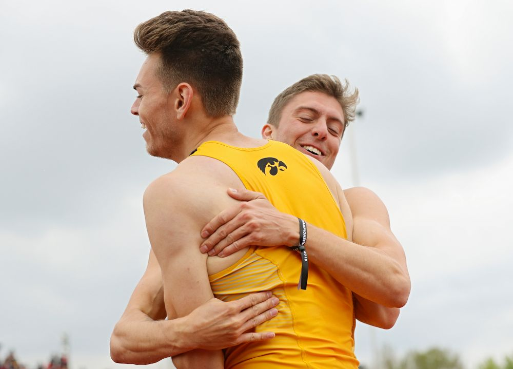 Iowa's Chris Douglas (from left) gets a hug from Noah Larrison after Douglas won the men's 400 meter hurdles event on the third day of the Big Ten Outdoor Track and Field Championships at Francis X. Cretzmeyer Track in Iowa City on Sunday, May. 12, 2019. (Stephen Mally/hawkeyesports.com)