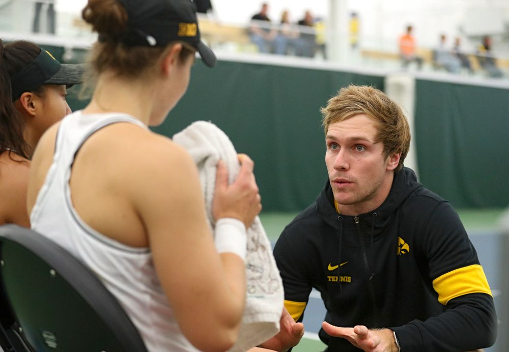 Daniel Leitner (right), program coordinator, talks with Michelle Bacalla (left) and Elise Van Heuvelen (center) during their doubles match at the Hawkeye Tennis and Recreation Complex in Iowa City on Sunday, February 16, 2020. (Stephen Mally/hawkeyesports.com)