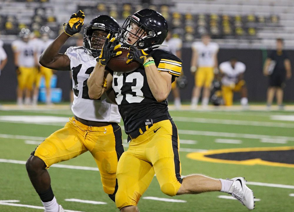 Iowa Hawkeyes wide receiver Alec Kritta (83) pulls in a pass around defensive back D.J. Johnson (12) during Fall Camp Practice No. 12 at Kinnick Stadium in Iowa City on Thursday, Aug 15, 2019. (Stephen Mally/hawkeyesports.com)