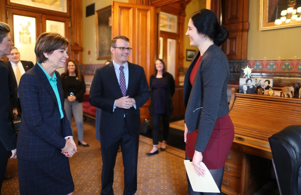 IowaÕs Megan Gustafson meets with Governor Kim Reynolds and Lt. Governor Adam Gregg at the Iowa State Capitol Wednesday, April 24, 2019 in Des Moines. (Brian Ray/hawkeyesports.com)