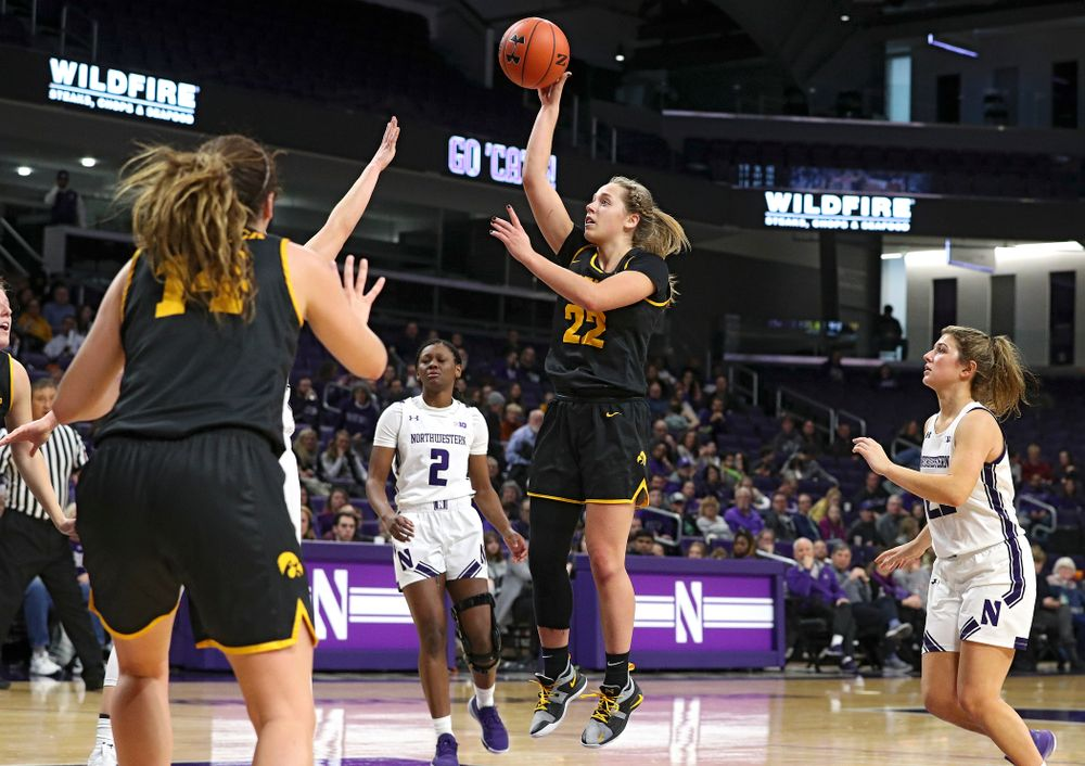 Iowa Hawkeyes guard Kathleen Doyle (22) scores a basket during the fourth quarter of their game at Welsh-Ryan Arena in Evanston, Ill. on Sunday, January 5, 2020. (Stephen Mally/hawkeyesports.com)