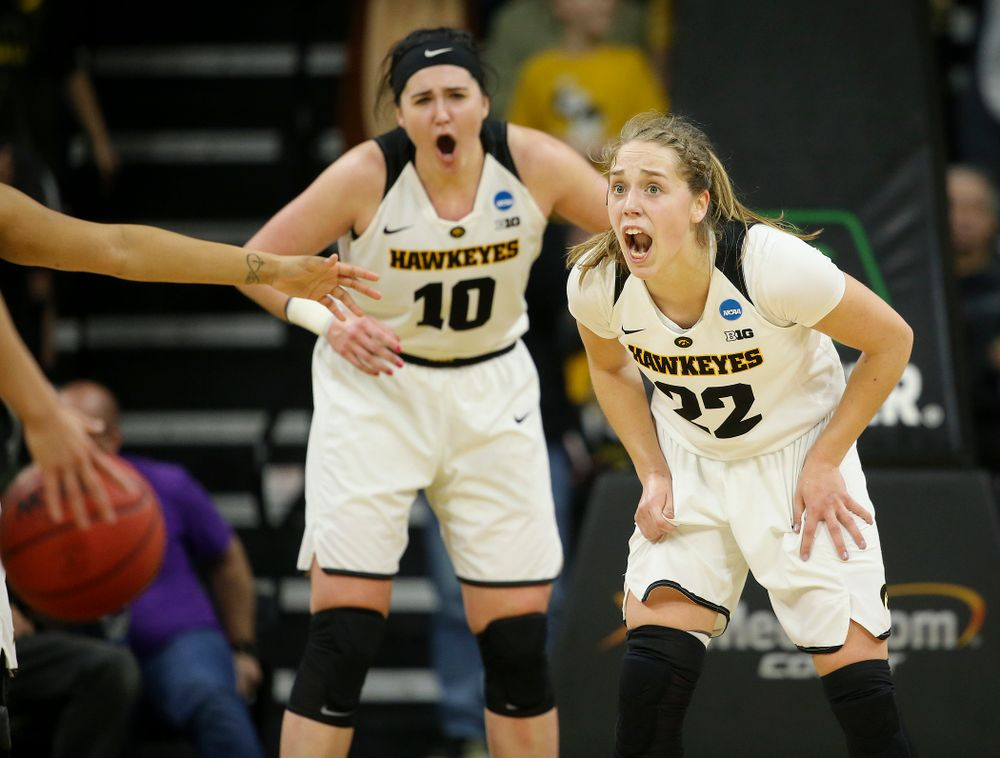 Iowa Hawkeyes center Megan Gustafson (10) and guard Kathleen Doyle (22) shout during the third quarter of their second round game in the 2019 NCAA Women's Basketball Tournament at Carver Hawkeye Arena in Iowa City on Sunday, Mar. 24, 2019. (Stephen Mally for hawkeyesports.com)