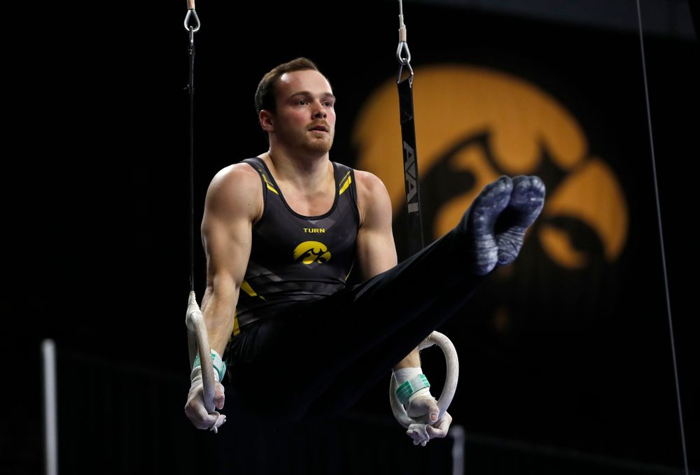 Dylan Ellsworth competes on the rings against Illinois
