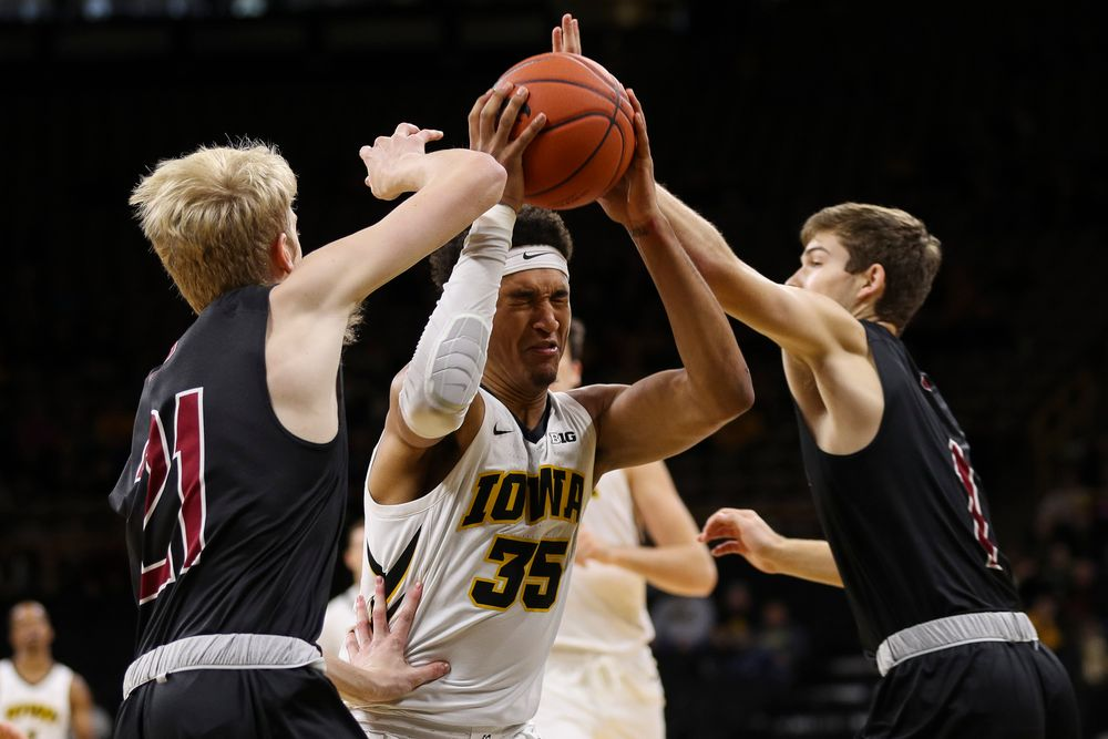 Iowa Hawkeyes forward Cordell Pemsl (35) is fouled on his way to the basket during a game against Guilford College at Carver-Hawkeye Arena on November 4, 2018. (Tork Mason/hawkeyesports.com)
