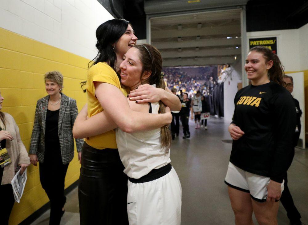 Megan Gustafson hugs Iowa Hawkeyes forward McKenna Warnock (14) following a jersey retirement ceremony Sunday, January 26, 2020 at Carver-Hawkeye Arena. (Brian Ray/hawkeyesports.com)
