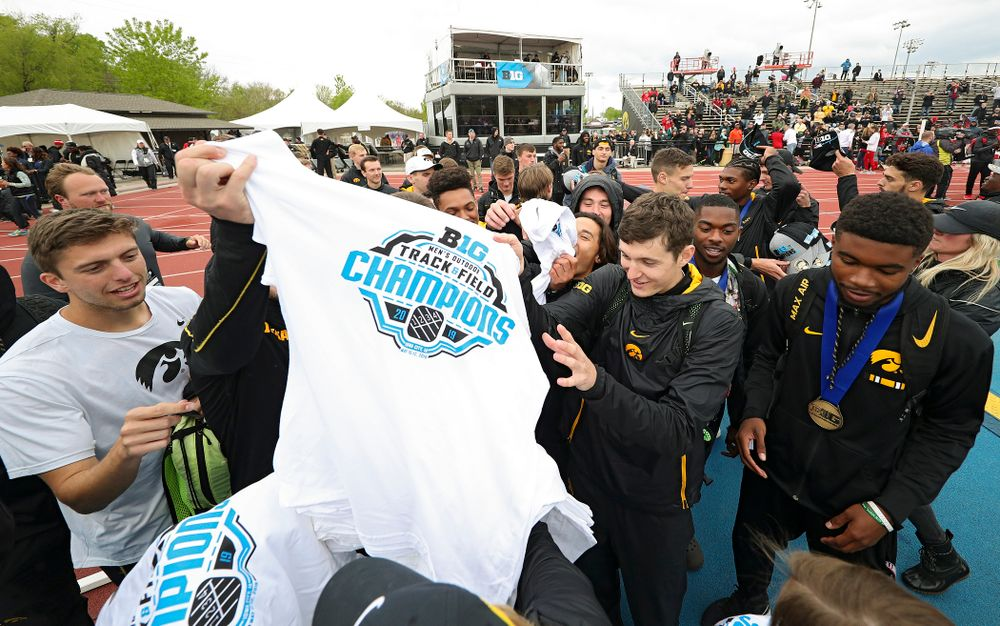 Championship shirts and hats are handed out to the Hawkeyes after winning the Men's Big Ten Outdoor Track and Field Championships on the third day of the Big Ten Outdoor Track and Field Championships at Francis X. Cretzmeyer Track in Iowa City on Sunday, May. 12, 2019. (Stephen Mally/hawkeyesports.com)