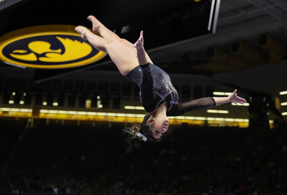 Iowa's Nicole Chow competes on the beem against Illinois Saturday, February 16, 2019 at Carver-Hawkeye Arena. (Brian Ray/hawkeyesports.com)