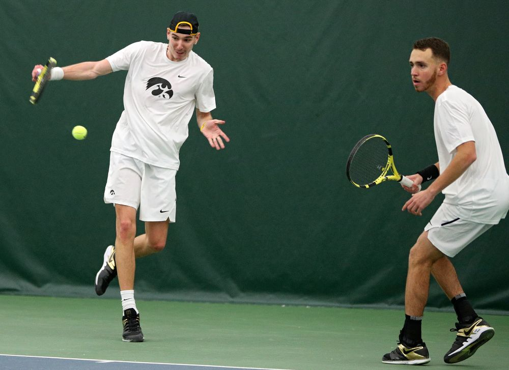 Iowa's Nikita Snezhko (from left) returns a shot as Kareem Allaf looks on during their doubles match at the Hawkeye Tennis and Recreation Complex in Iowa City on Sunday, February 16, 2020. (Stephen Mally/hawkeyesports.com)
