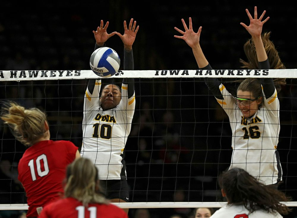 Iowa's Griere Hughes (10) blocks a shot as Grace Tubbs (16) looks on during the third set of their match against Nebraska at Carver-Hawkeye Arena in Iowa City on Saturday, Nov 9, 2019. (Stephen Mally/hawkeyesports.com)