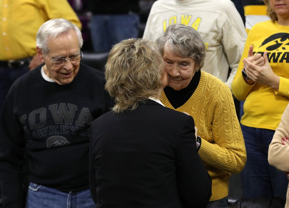 Iowa Hawkeyes head coach Lisa Bluder kisses her mother before their game against the Northwestern Wildcats Sunday, March 3, 2019 at Carver-Hawkeye Arena. (Brian Ray/hawkeyesports.com)