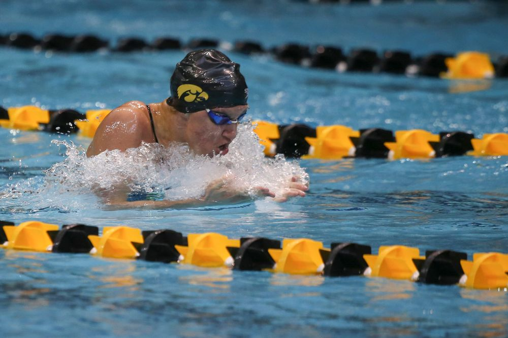 Iowa's Sage Ohlensehlen swims the 100-yard breaststroke during the Iowa swimming and diving meet vs Notre Dame and Illinois on Saturday, January 11, 2020 at the Campus Recreation and Wellness Center. (Lily Smith/hawkeyesports.com)