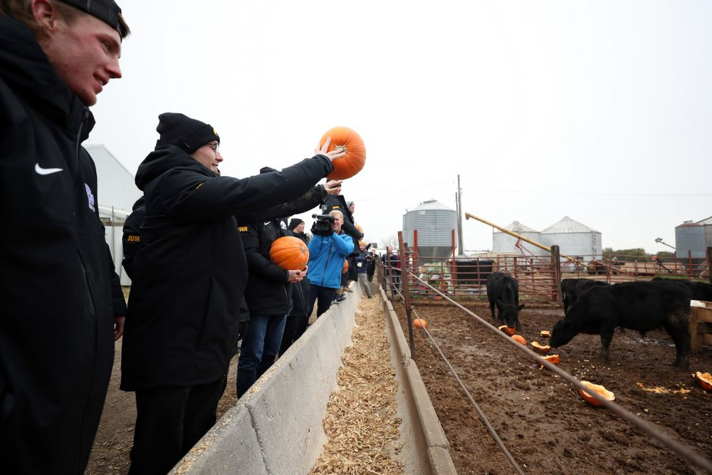 Spencer Lee tosses a pumpkin into the cow pen during the teamÕs annual media day Wednesday, October 30, 2019 at Kroul Family Farms in Mount Vernon. (Brian Ray/hawkeyesports.com)
