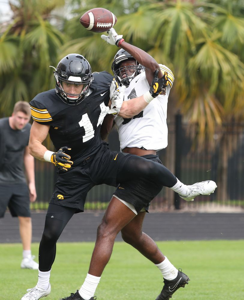 Iowa Hawkeyes wide receiver Kyle Groeneweg (14) and defensive back Michael Ojemudia (11) as the team prepares for the Outback Bowl Saturday, December 29, 2018 at Tampa University. (Brian Ray/hawkeyesports.com)