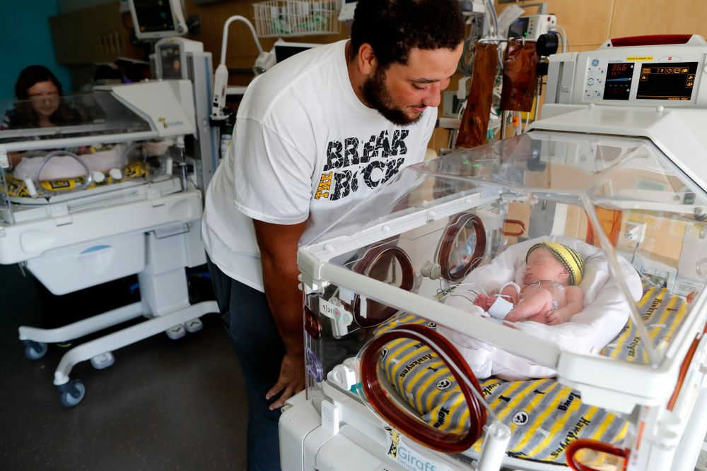 Iowa Hawkeyes offensive lineman Dalton Ferguson (76) and his girlfriend Rachael stand with their newborn twins Ella and Hazel Wednesday, September 12, 2018 in the NICU at the Stead Family Children's Hospital (Brian Ray/hawkeyesports.com)