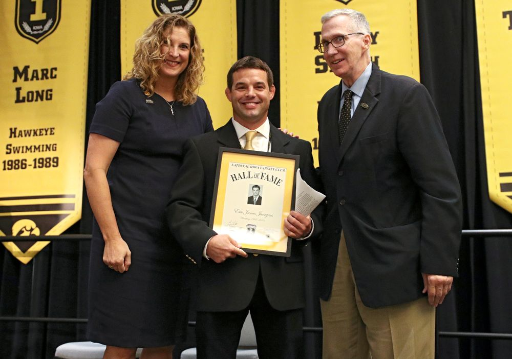 Barb Randall (from left), co-chair of the Varsity Club Advisory Committee, 2019 University of Iowa Athletics Hall of Fame inductee Eric Juergens, and Andy Piro, assistant athletics director and executive director of the Varsity Club, during the Hall of Fame Induction Ceremony at the Coralville Marriott Hotel and Conference Center in Coralville on Friday, Aug 30, 2019. (Stephen Mally/hawkeyesports.com)