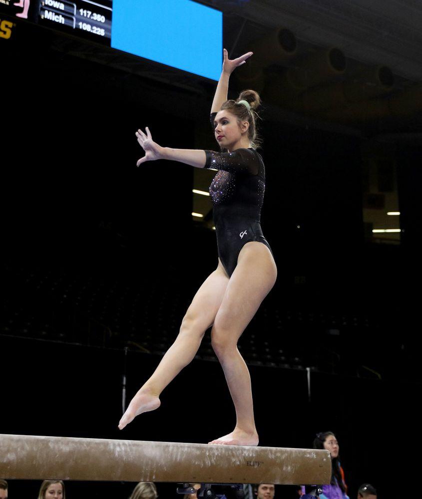 Iowa's Bridget Killian competes on the beam against Michigan Friday, February 14, 2020 at Carver-Hawkeye Arena. (Brian Ray/hawkeyesports.com)