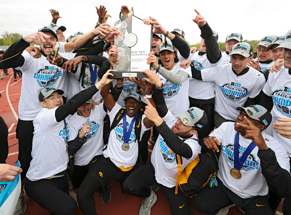 The Hawkeyes hold up their team trophy after winning the Men's Big Ten Outdoor Track and Field Championships on the third day of the Big Ten Outdoor Track and Field Championships at Francis X. Cretzmeyer Track in Iowa City on Sunday, May. 12, 2019. (Stephen Mally/hawkeyesports.com)