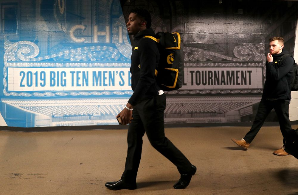 Iowa Hawkeyes forward Tyler Cook (25) arrives for their game against the Illinois Fighting Illini in the 2019 Big Ten Men's Basketball Tournament Thursday, March 14, 2019 at the United Center in Chicago. (Brian Ray/hawkeyesports.com)