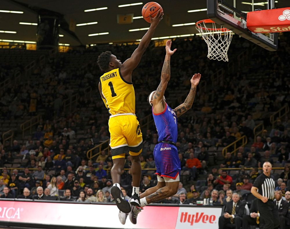 Iowa Hawkeyes guard Joe Toussaint (1) scores a basket during the second half of their game at Carver-Hawkeye Arena in Iowa City on Monday, Nov 11, 2019. (Stephen Mally/hawkeyesports.com)