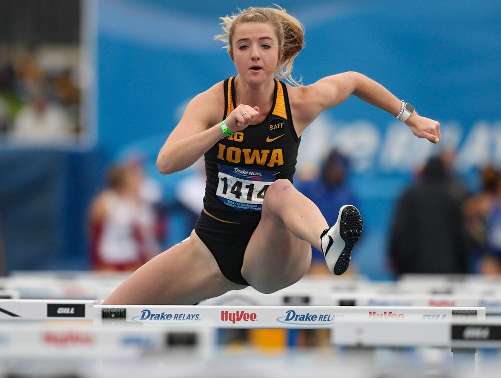 Iowa's Sydney Winger runs the women's shuttle hurdles event during the third day of the Drake Relays at Drake Stadium in Des Moines on Saturday, Apr. 27, 2019. (Stephen Mally/hawkeyesports.com)