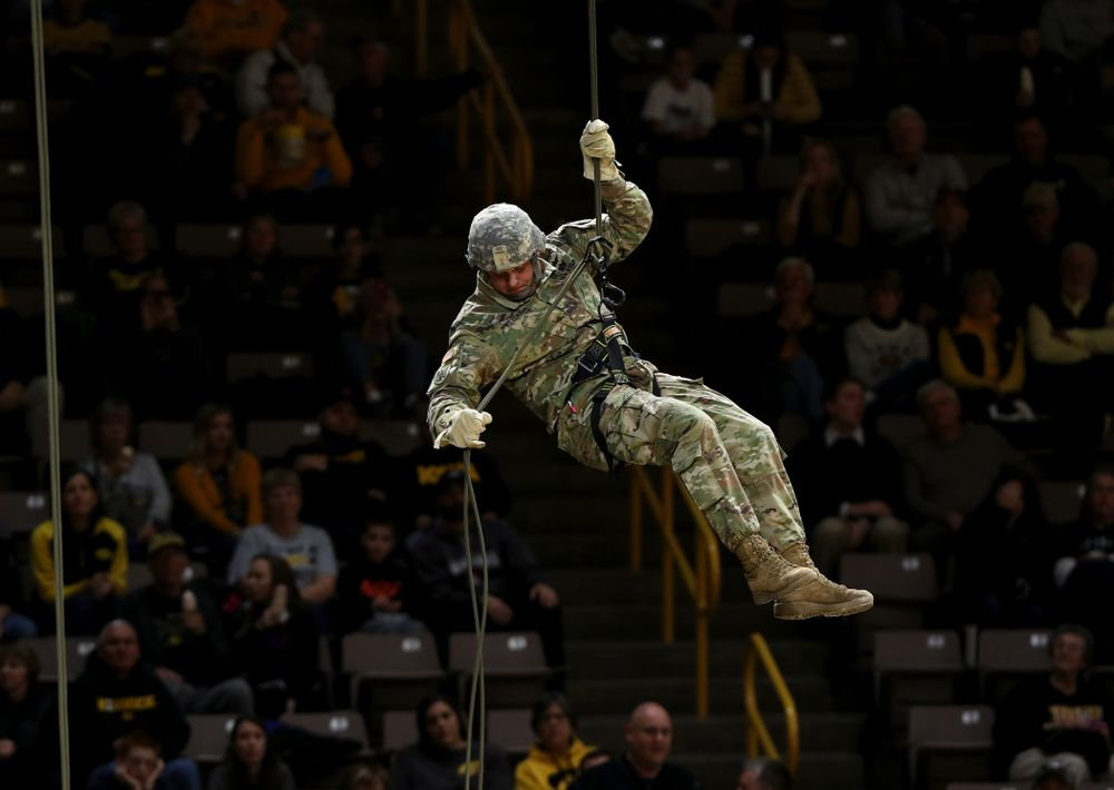 Members of the University of Iowa ROTC cadre repel down from the rafters before the Iowa Hawkeyes game against UW Green Bay Sunday, November 11, 2018 at Carver-Hawkeye Arena. (Brian Ray/hawkeyesports.com)