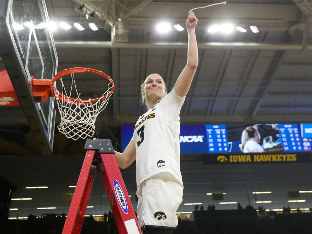Iowa Hawkeyes guard Makenzie Meyer (3) cuts down the net after winning their second round game in the 2019 NCAA Women's Basketball Tournament at Carver Hawkeye Arena in Iowa City on Sunday, Mar. 24, 2019. (Stephen Mally for hawkeyesports.com)