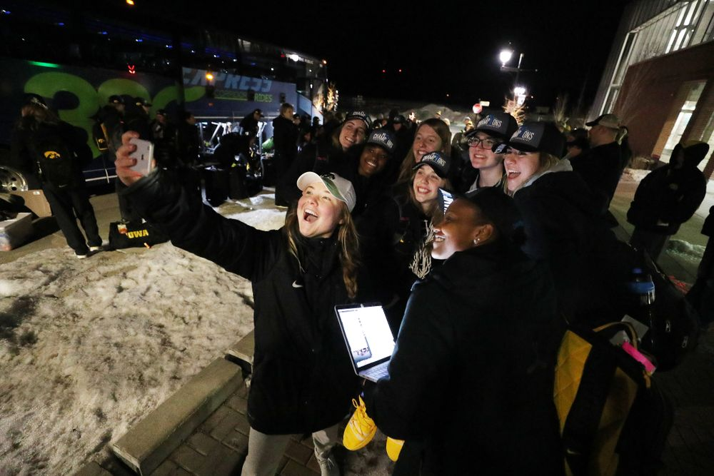 The Iowa Hawkeyes celebrate with fans as they arrive back in Coralville after defeating the Maryland Terrapins in the Big Ten Championship Game Sunday, March 10, 2019 in Indianapolis, Ind. (Brian Ray/hawkeyesports.com)