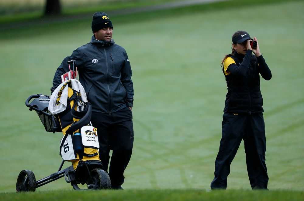 Iowa assistant coach Michael Roters gives advice as Iowa's Brett Permann checks the distance to the pin during the Diane Thomason Invitational at Finkbine Golf Course on September 29, 2018. (Tork Mason/hawkeyesports.com)