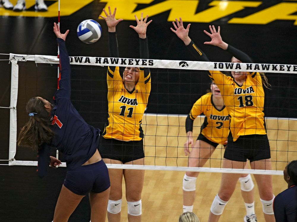 Iowa's Blythe Rients (11) and Hannah Clayton (18) try for a block during the first set of their match against Illinois at Carver-Hawkeye Arena in Iowa City on Wednesday, Nov 6, 2019. (Stephen Mally/hawkeyesports.com)