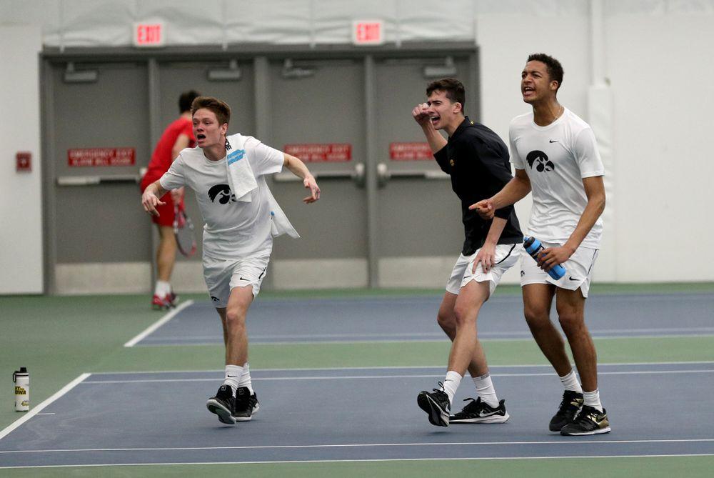 The Iowa Hawkeyes cheer on Nikita Snezhko against Cornell Sunday, March 8, 2020 at the Hawkeye Tennis and Recreation Center. (Brian Ray/hawkeyesports.com)