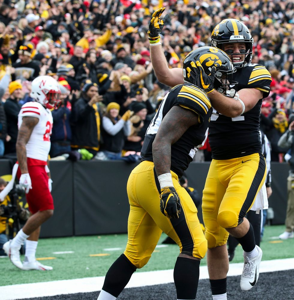 Iowa Hawkeyes wide receiver Nick Easley (84) and Iowa Hawkeyes running back Mekhi Sargent (10) celebrate after Sargent's touchdown run