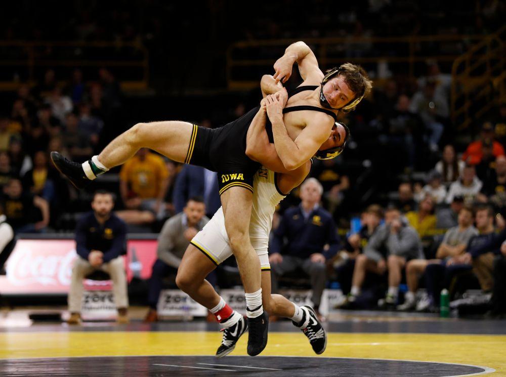 Iowa's Jeren Glosser against Michigan's Alex Pantaleo at 157 pounds