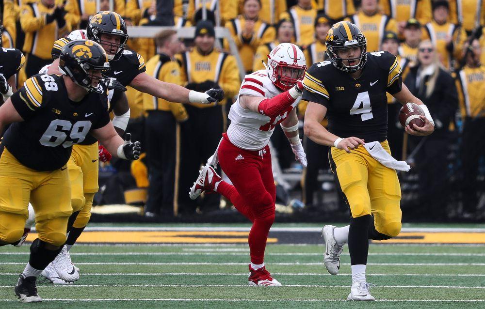 Iowa Hawkeyes quarterback Nate Stanley (4) runs the ball during a game against Nebraska at Kinnick Stadium on November 23, 2018. (Tork Mason/hawkeyesports.com)