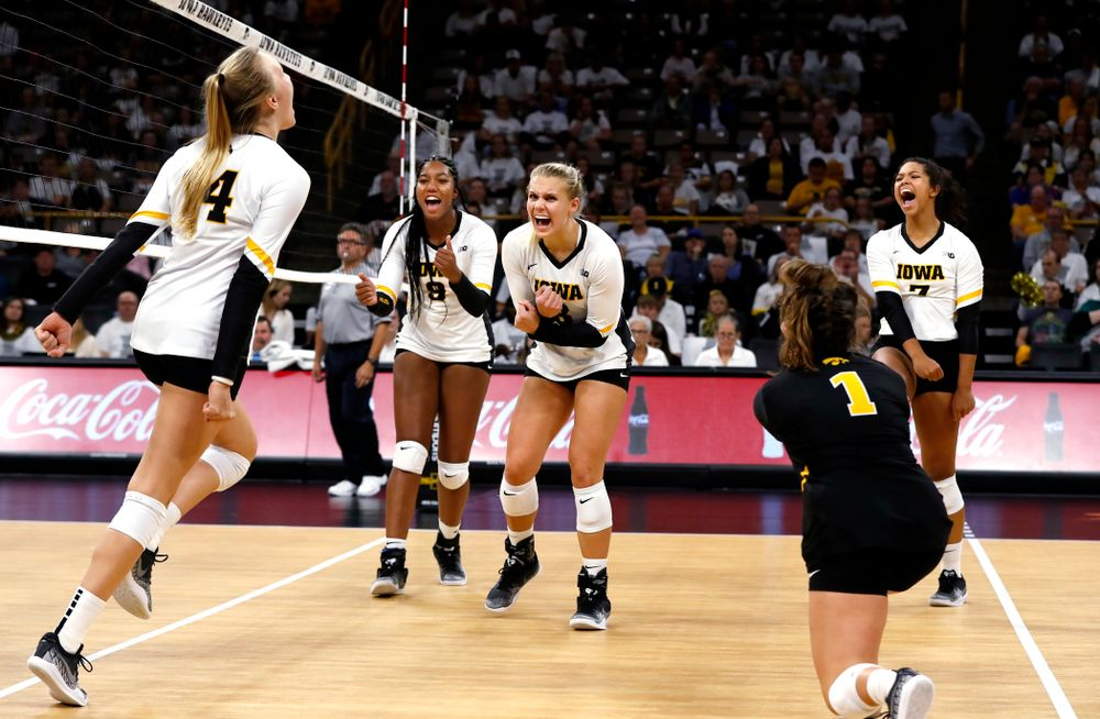 Iowa Hawkeyes right side hitter Reghan Coyle (8) and middle blocker Amiya Jones (9) against the Michigan State Spartans Friday, September 21, 2018 at Carver-Hawkeye Arena. (Brian Ray/hawkeyesports.com)