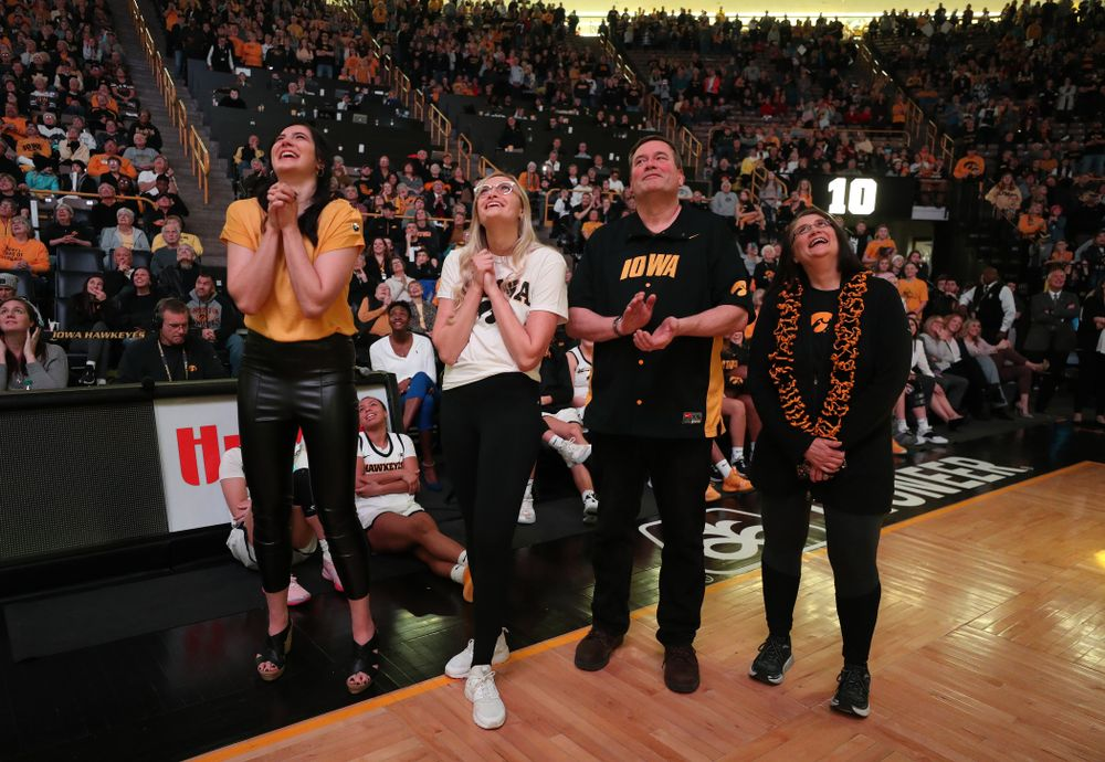 Megan Gustafson watches a video message from her teammates and coaches after her number was raised into the rafters during a jersey retirement ceremony Sunday, January 26, 2020 at Carver-Hawkeye Arena. (Brian Ray/hawkeyesports.com)