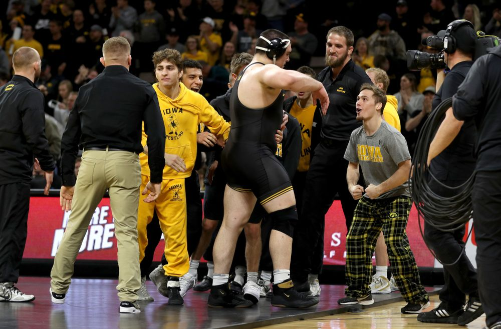 IowaÕs Tony Cassioppi celebrates with teammate Spencer Lee after defeating WisconsinÕs Trent Hillger at heavyweight Sunday, December 1, 2019 at Carver-Hawkeye Arena. Cassioppi won the match 3-2. (Brian Ray/hawkeyesports.com)