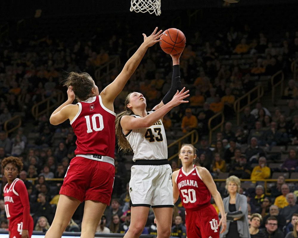 Iowa Hawkeyes forward Amanda Ollinger (43) makes a basket during the third quarter of their game at Carver-Hawkeye Arena in Iowa City on Sunday, January 12, 2020. (Stephen Mally/hawkeyesports.com)