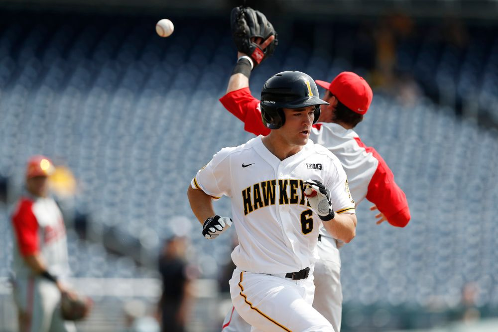 Iowa Hawkeyes outfielder Justin Jenkins (6) puts down a bunt for a single against the Ohio State Buckeyes in the second round of the Big Ten Baseball Tournament  Thursday, May 24, 2018 at TD Ameritrade Park in Omaha, Neb. (Brian Ray/hawkeyesports.com)