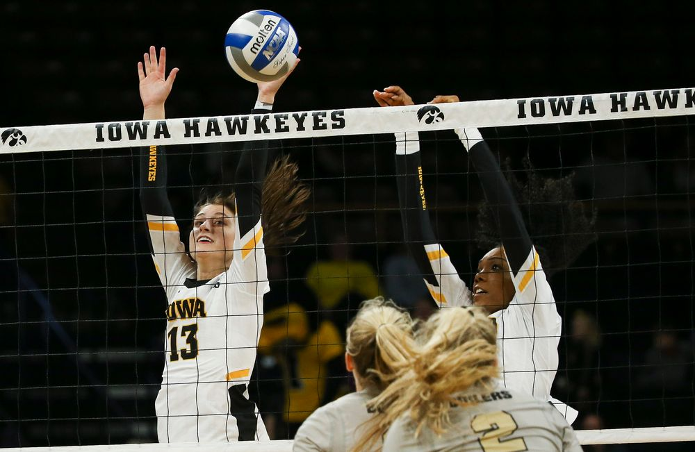 Iowa Hawkeyes middle blocker Sara Wing (13) goes up for a block during a game against Purdue at Carver-Hawkeye Arena on October 13, 2018. (Tork Mason/hawkeyesports.com)