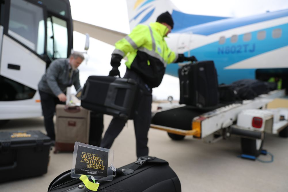 The Iowa Hawkeyes board a flight to Columbus for the first and second rounds of the 2019 NCAA Men's Basketball Tournament Wednesday, March 20, 2019 at the Eastern Iowa Airport. (Brian Ray/hawkeyesports.com)