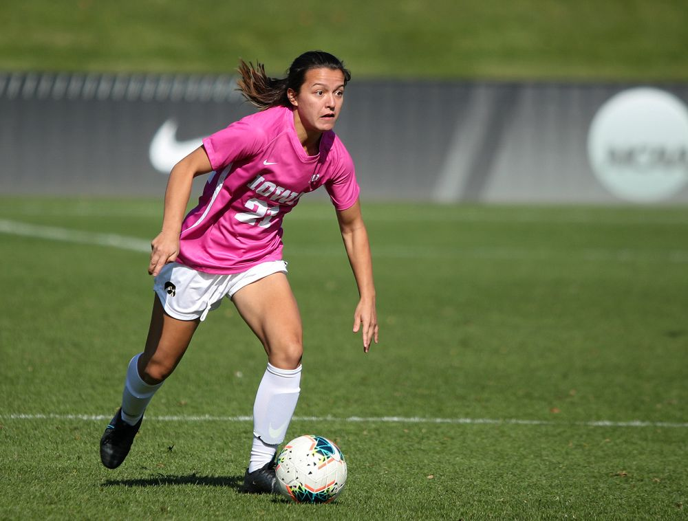 Iowa forward Emma Tokuyama (21) looks down field as she moves with the ball during the first half of their match at the Iowa Soccer Complex in Iowa City on Sunday, Oct 27, 2019. (Stephen Mally/hawkeyesports.com)