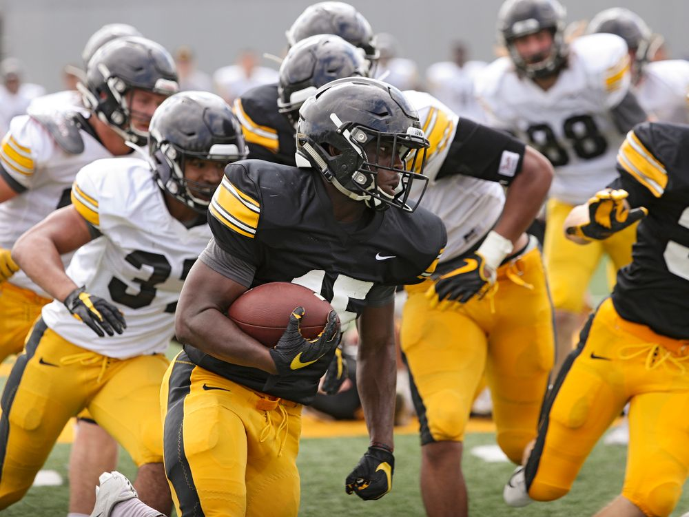 Iowa Hawkeyes running back Tyler Goodson (15) gets around the end for a touchdown run during Fall Camp Practice No. 10 at the Hansen Football Performance Center in Iowa City on Tuesday, Aug 13, 2019. (Stephen Mally/hawkeyesports.com)