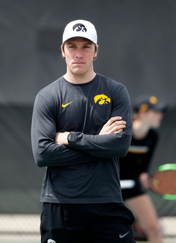 Assistant coach Daniel Leitner against the Wisconsin Badgers Sunday, April 22, 2018 at the Hawkeye Tennis and Recreation Center. (Brian Ray/hawkeyesports.com)