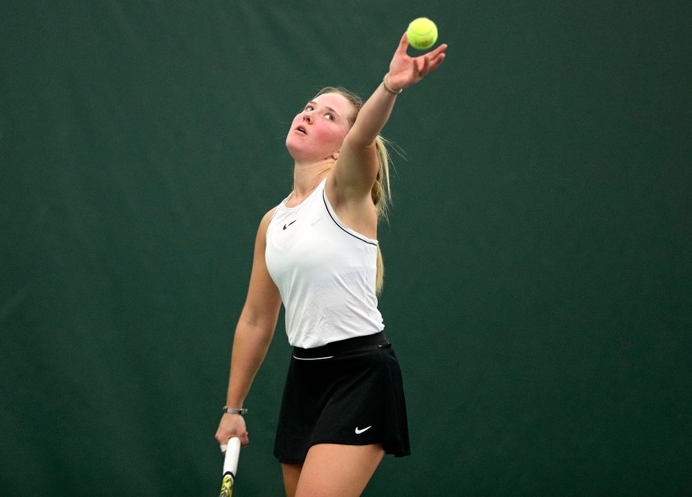 Iowa's Danielle Burich serves during her singles match at the Hawkeye Tennis and Recreation Complex in Iowa City on Sunday, February 16, 2020. (Stephen Mally/hawkeyesports.com)